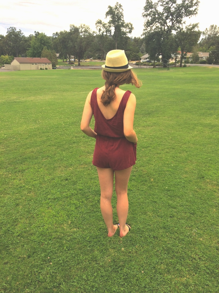 Red romper with fedora hat