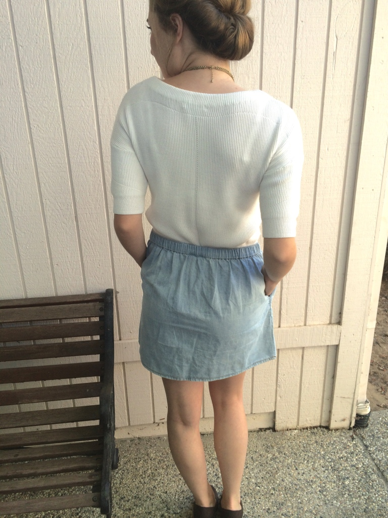 Updo hairstyle, white sweater, blue skirt, brown wedges, pink necklace