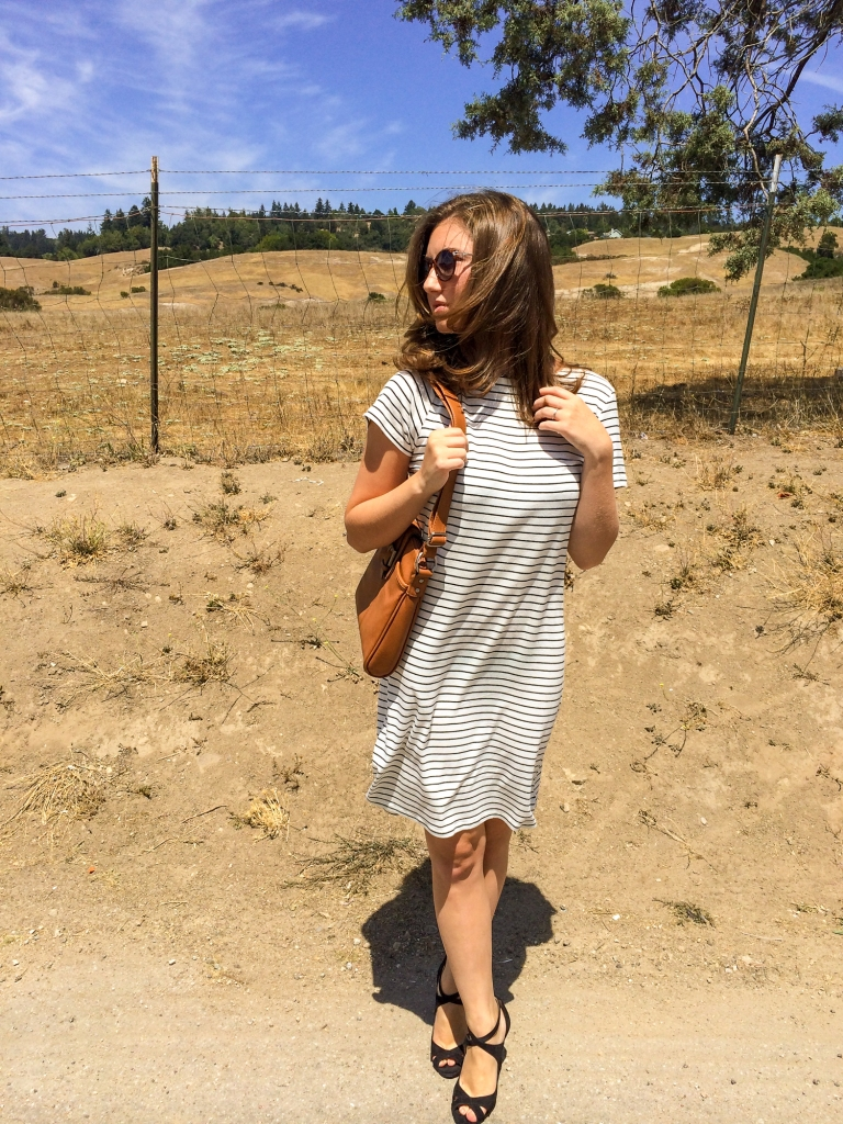 Black and white striped dress, black stripy heels, brown leather purse, brown sunglasses