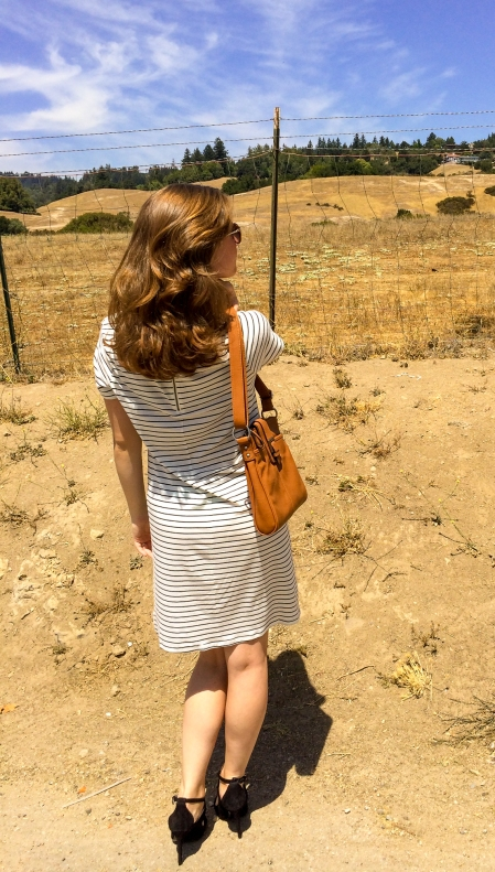 Black and white striped dress, brown leather purse, black stripy heels.