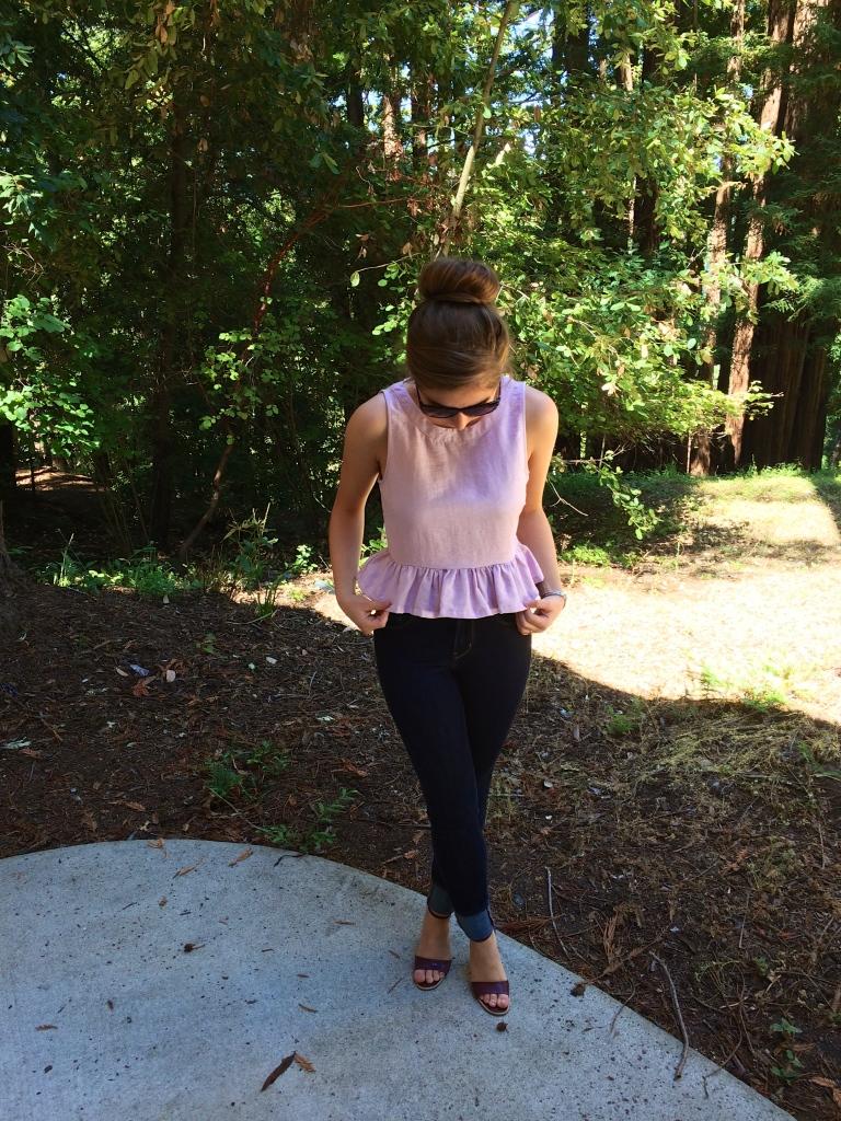 Levis jeans, red heels, sunglasses, pink peplum top