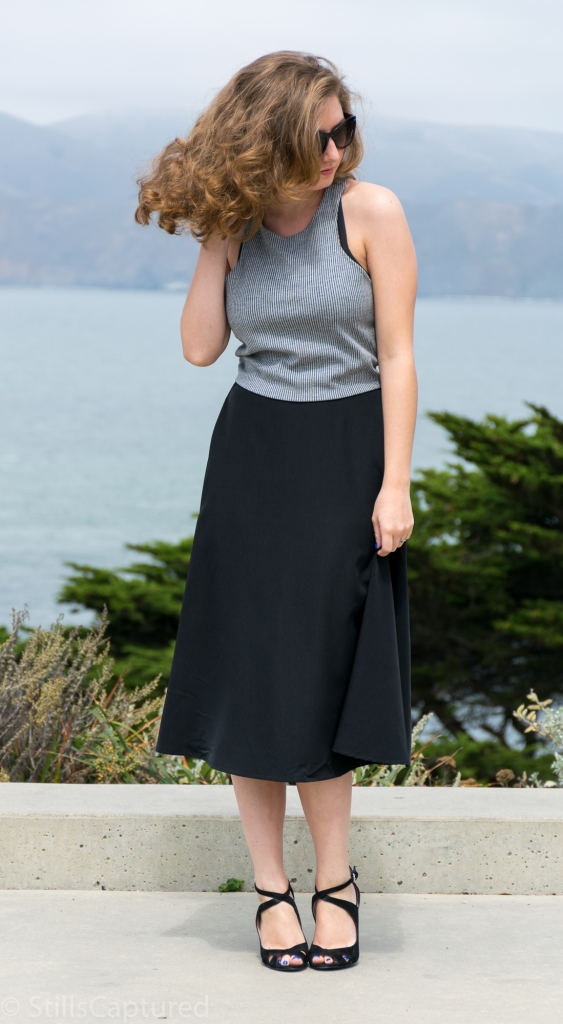 Black and White striped crop top, Black high wasted long skirt, Black Strappy Heels, Big Sunglasses, Wavy Hair