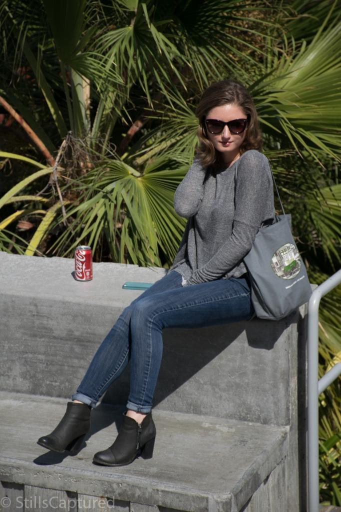 Oversized grey sweater, Cuffed Skinny Jeans, Black Booties, Sunglasses