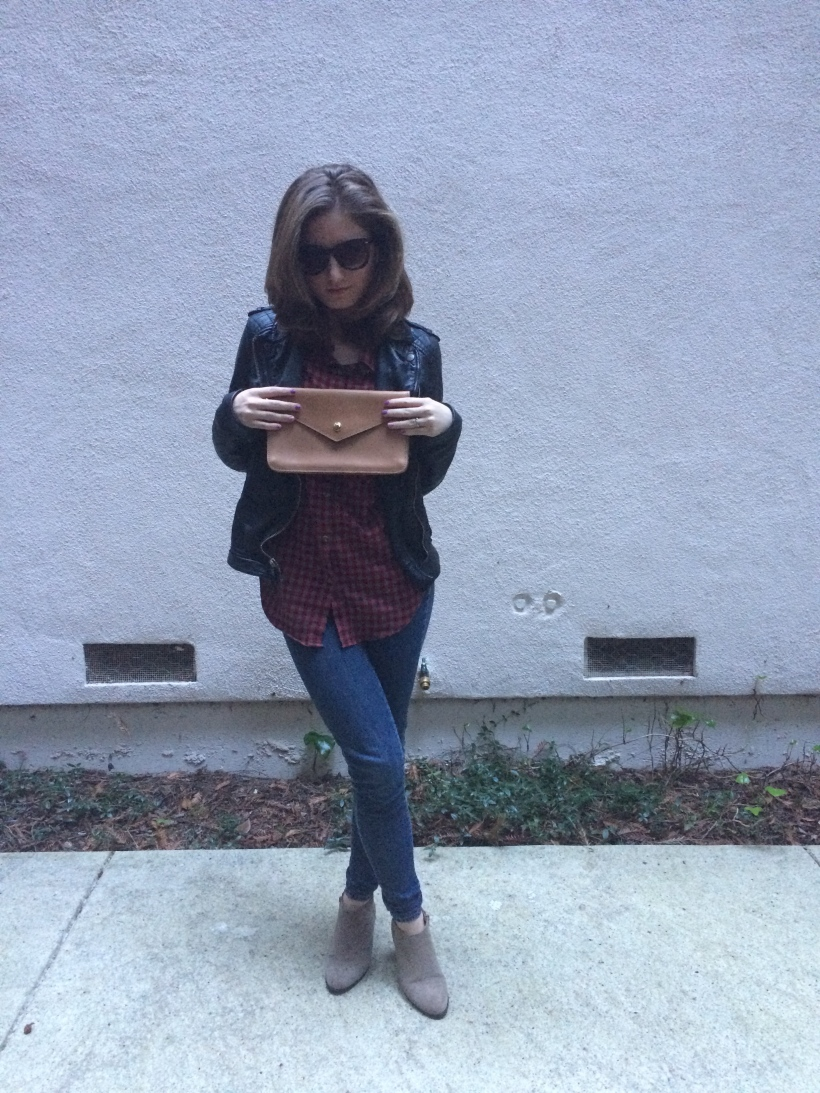 Leather clutch, leather jacket, flannel, skinny jeans, booties