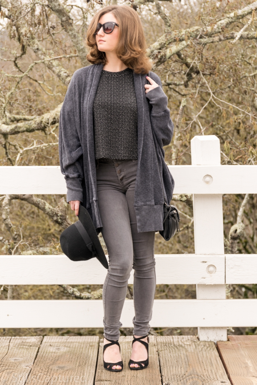 Grey cardigan, great t-shirt, gray high wasted pants, black hat, black purse, black heels