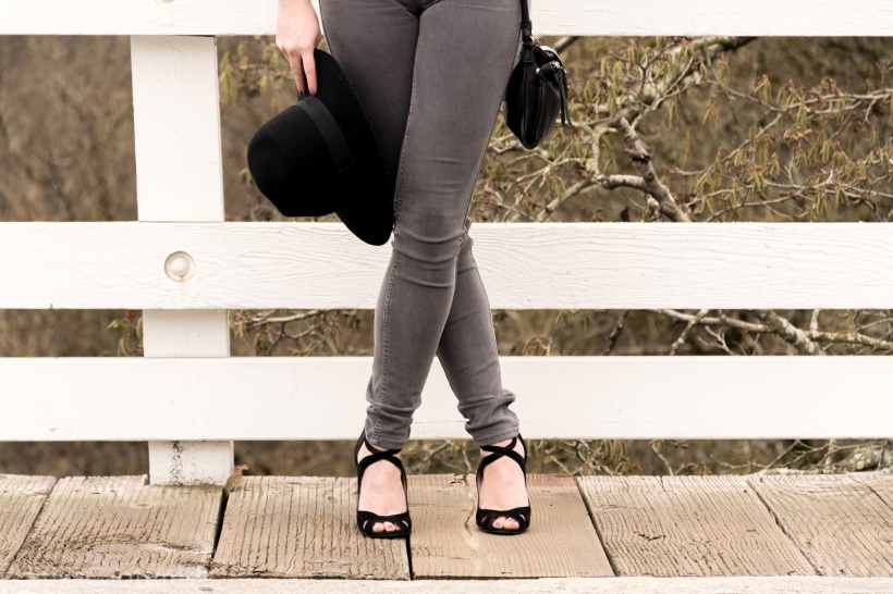 Gray high wasted pants, black hat, black purse, black heels