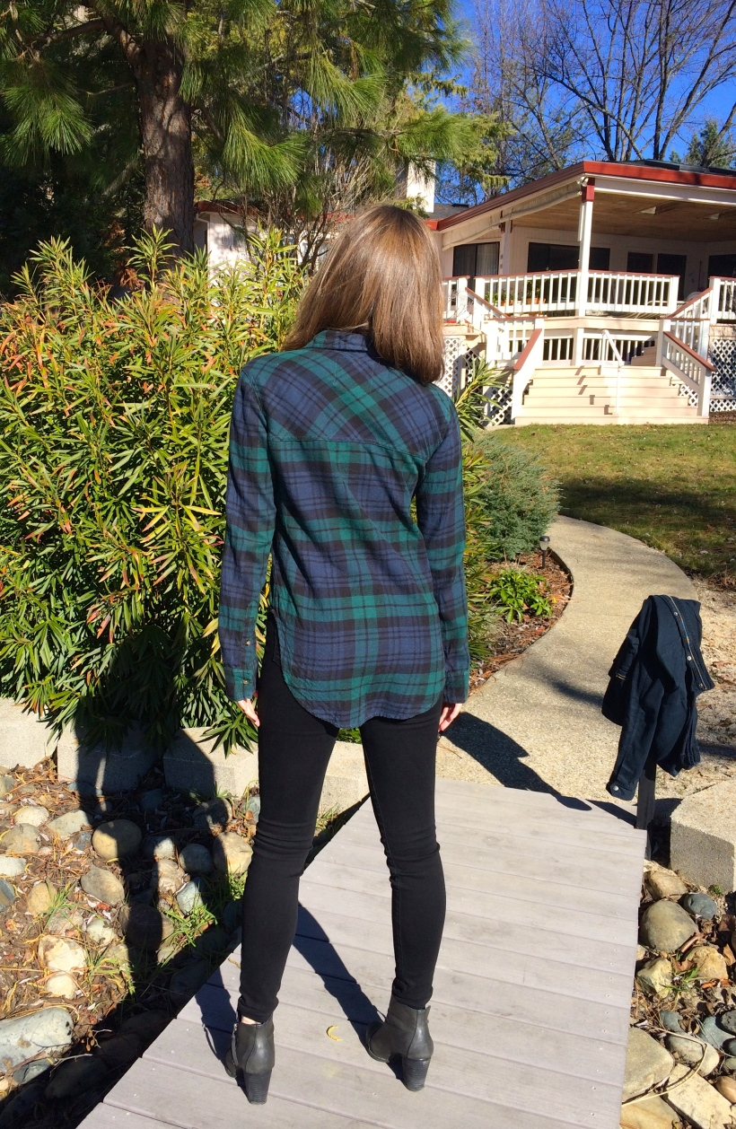 blue and green flannel, black jeans, booties
