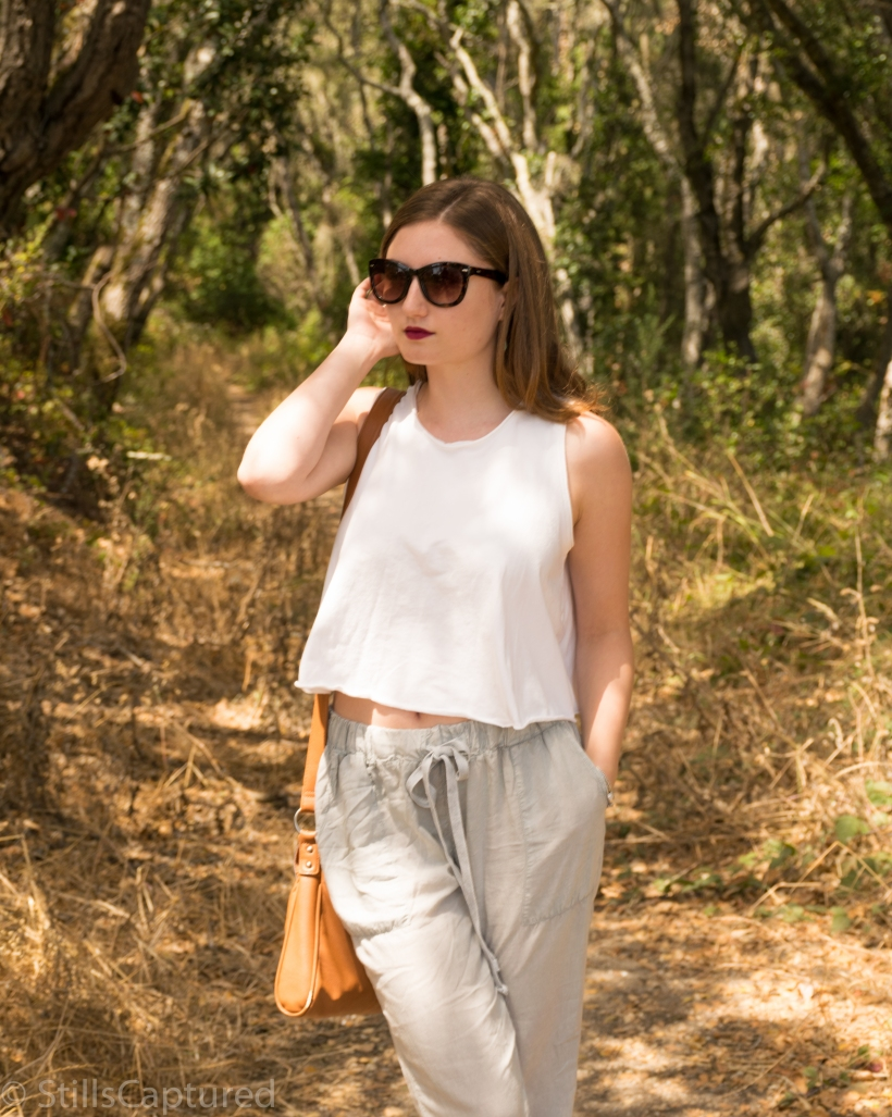 Urban Outfitters loose fitting tank top and pants, cross body purse, nordstrom sunnies, wedge pumps