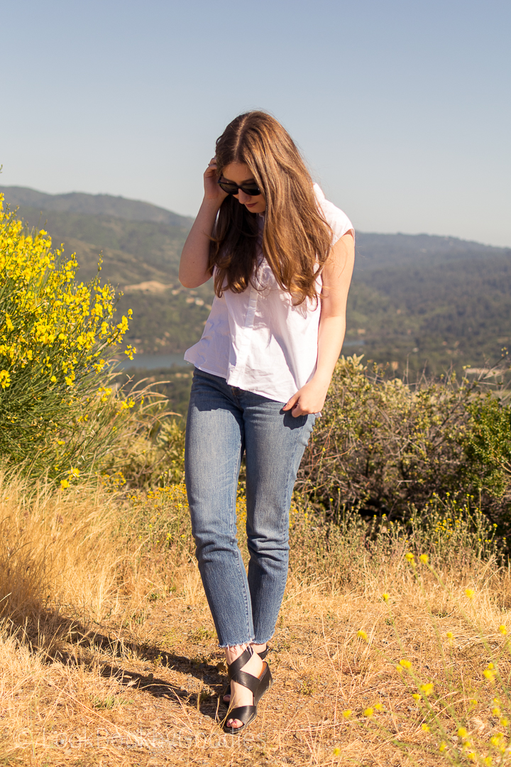 white button down, jeans, heels