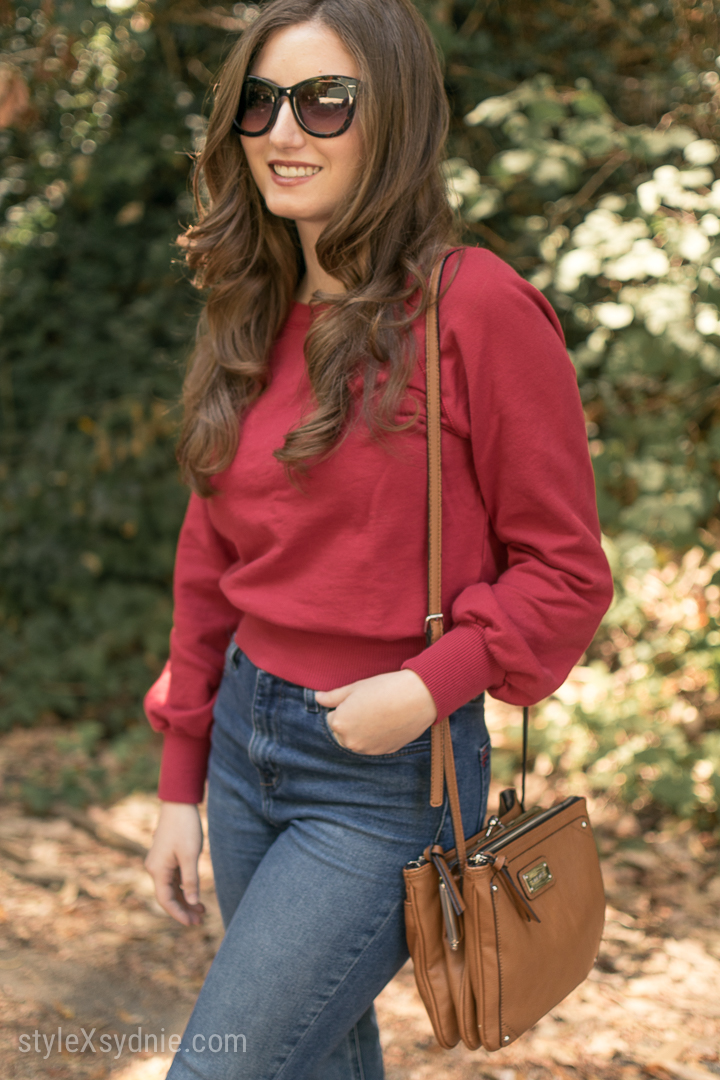 red sweatshirt, high waisted jeans, heeled slides, cross body purse