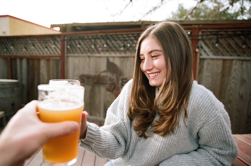 Woman and man toasting to the weekend with their beer glasses, picture