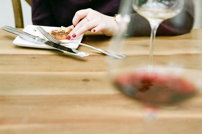woman eating bread and cheese with wine, picture